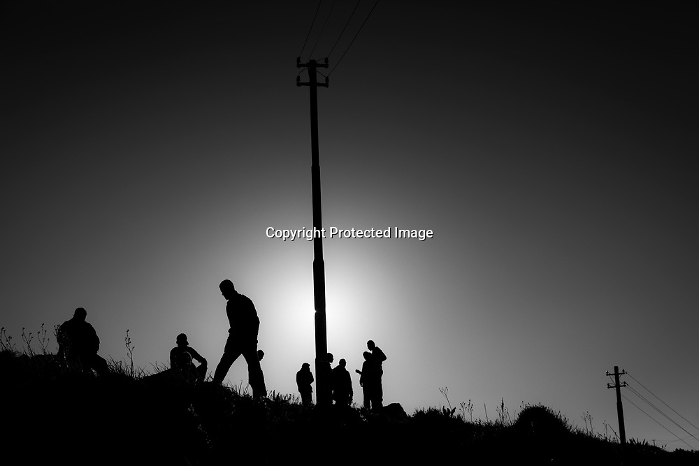 Migrants on the hill behind the camp