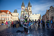 A street artist creating bubbles at Old Town Square in the capital of Czech Republic.
