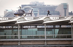 Tom Cruise runs along Blackfriars Bridge in London, during filming for Mission Impossible 6.