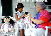 Active Aging Senior Citizens, Retired, Activities, Asian American Grandchild Plays Dolls with Grandmother, Child and Dolls, Child and Grandmother