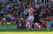 Liverpool's Roberto Firmino and Stoke's Charlie Adam in action. Premier league match, Stoke City v Liverpool at the Bet365 Stadium in Stoke on Trent, Staffs on Saturday 8th April 2017.<br /> pic by Bradley Collyer, Andrew Orchard sports photography.