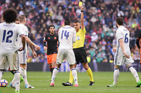 Referee shows yellow card to Real Madrid's Carlos Henrique Casemiroduring La Liga match between Real Madrid and Valencia CF at Santiago Bernabeu Stadium in Madrid, April 29, 2017. Spain.<br /> (ALTERPHOTOS/BorjaB.Hojas)