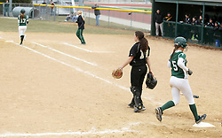30 March 2013:  Audra James scores the winning run on a hit by Allie Riordan during an NCAA Division III women's softball game between the DePauw Tigers and the Illinois Wesleyan Titans in Bloomington IL