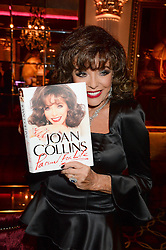 JOAN COLLINS at a party to celebrate the publication of 'Passion for Life' by Joan Collins held at No41 The Westbury Hotel, Mayfair, London on21st October 2013.