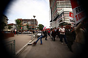 """Several hundred Albanian protesters, supporting the Socialist Party of Albania, on Saturday May 8, 2010, were gathered in front of the stadium """"Qemal Stafa"""", to march along the way then that sends towards building of the Albanian Public Television (TVSH ñTelevizioni Shqiptar), when protestors have fired broken eggs, to continue further along the road that lead towards the building of the Prime Minister of Albania, while in front of the building protestors have been sitting for 10 minutes as row chanting """"We want Albania without Saliî, to be collected after in the Boulevard of ìNation Martyrsî where strikers socialists umbrellas are placed. (Vedat Xhymshiti / ZUMA Press)"""