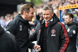 Huddersfield Town manager Jan Siewert (left) and Manchester United Manager Ole Gunnar Solskjaer shake hands ahead of the Premier League match at the John Smith's Stadium, Huddersfield.