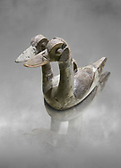 Hittite terra cotta ritual vessel in the shape of a duck with two heads - 16th century BC - Hattusa ( Bogazkoy ) - Museum of Anatolian Civilisations, Ankara, Turkey . Against grey art background .<br /> <br /> If you prefer to buy from our ALAMY STOCK LIBRARY page at https://www.alamy.com/portfolio/paul-williams-funkystock/hittite-art-antiquities.html  - Type Hattusa into the LOWER SEARCH WITHIN GALLERY box. Refine search by adding background colour, place, museum etc<br /> <br /> Visit our HITTITE PHOTO COLLECTIONS for more photos to download or buy as wall art prints https://funkystock.photoshelter.com/gallery-collection/The-Hittites-Art-Artefacts-Antiquities-Historic-Sites-Pictures-Images-of/C0000NUBSMhSc3Oo