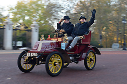 Participants in the Bonhams London to Brighton Veteran Car Run pass along The Mall in central London.
