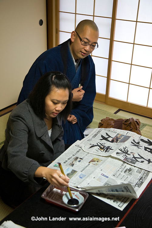"""Japanese Calligraphy Lesson at Taizo-in well-known for opening its doors to visitors and casual tourists in order to teaching Zen Buddhism, including """"Zen Experience"""" visits which include calligraphy sessions, tea ceremony, and a vegetarian lunch called shojin ryori - a special gourmet assortment of vegetarian dishes."""
