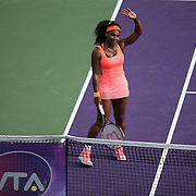 Serena Williams, of the United States, waves to the crowd after defeating Monica Niculescu, of Romania, during their match at the Miami Open tennis tournament on Saturday, March 28, 2015 in Key Biscayne, Florida. (AP Photo/Alex Menendez)