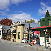 Arrowtown High Street in Autumn. .Arrowtown is the much visited, historic, 4-season, southern hemisphere holiday destination, located only 20 minutes drive from Queenstown, South Island, New Zealand..Arrowtown is a former gold-mining town built on the banks of the Arrow River, once a rich source of gold in the 1860's and now a sophisticated, multi-cultural town catering visitors from around the globe. Arrowtown offers an ambiance with its shops, restaurants, cafes, offices and galleries located within a tight precinct.  5th April 2011.  Photo Tim Clayton.