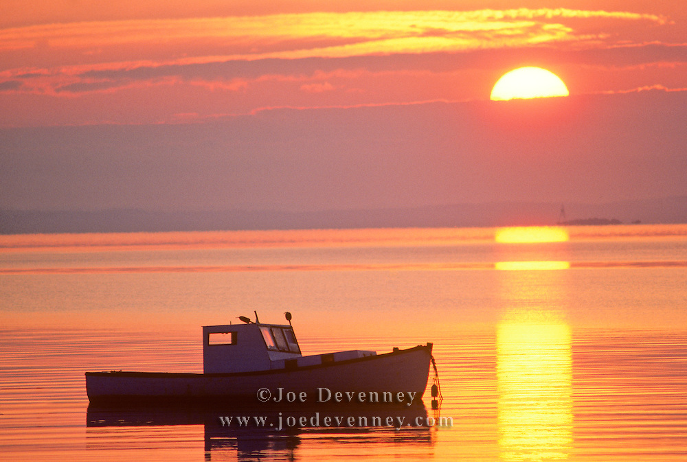 Lobster boat on its mooring at sunrise in Rockland Harbor. Maine