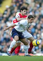 13/11/2004 - FA Barclays Premiership - Tottenham Hotspur v Arsenal - White Hart Lane<br />Tottenham's Michael Brown holds off Arsenal's Francesc Fabregas<br />Photo:Jed Leicester/Back page images