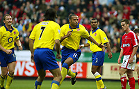 Photo. Chris Ratcliffe<br />Charlton v Arsenal. FA Premiership. 26/10/2003<br />Thierry Henry turns to celebrate as Pires, Cole and Parlour look on. Scott Parker is the Arsenal player