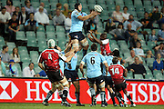 Waratah Dean Mumm catches a restart kick. Super 14 Rugby Union, Waratahs v Lions, Sydney Football Stadium, Australia. Friday 12 March 2010. Photo: Clay Cross/PHOTOSPORT
