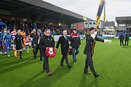 AFC Wimbledon players walking out with poppy reef during the The FA Cup match between AFC Wimbledon and Doncaster Rovers at the Cherry Red Records Stadium, Kingston, England on 9 November 2019.