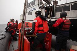 USA ALASKA BERING SEA 10JUL12 - Greenpeace crew members interview fishermen aboard The Mystery, a fishing boat catching Halibut in the Bering Sea, Alaska.....Photo by Jiri Rezac / Greenpeace....© Jiri Rezac / Greenpeace