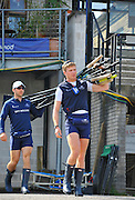 London, UK,  2014 Varsity, Annual Tideway Week. OUBC, Oxford University Boat Club, Blue Boat, Sam O'CONNOR (left) and Constantine LOULOUDIS (right)) carry oars from the Boathouse.  09:00:19  Tuesday  01/04/2014  : [Mandatory Credit Intersport Images]
