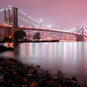 The Brooklyn Bridge as seen from Brooklyn.  1595.5 feet long and completed in 1883, it is a National Historic Landmark that connects Manhattan and Brooklyn by spanning the East River.