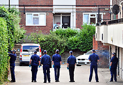 © Licensed to London News Pictures. 08/08/2018<br /> Deptford, UK. Police search team searching garage area opposite a property where 7 year Joel Urhie was killed in a suspicious house fire at Adolphus Street, Deptford.  <br /> Photo credit: Grant Falvey/LNP