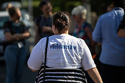 """© Licensed to London News Pictures. 19/07/2018. Salford, UK. A protester wearing a t-shirt with """" We believe in drew """" on the back . Harrop Fold School in Little Hulton is closed for a protest by parents , objecting to the outcome of a months-long investigation in to record keeping which, it is alleged, revealed that data relating to pupils' performance was embellished and which has seen the school's popular headmaster suspended from duty. Parents planned a protest following the suspension of head master Drew Povey alongside three other members of staff . The school , which has been featured in the documentary """" Educating Greater Manchester """" will remain closed throughout the day . Photo credit: Joel Goodman/LNP"""