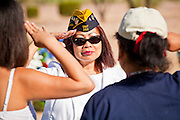 30 MAY 2011 - PHOENIX, AZ: Women salute a US Navy veteran at Memorial Day services in the National Memorial Cemetery in Phoenix, AZ, Monday. Memorial Day was celebrated with services across the United States Monday.    Photo by Jack Kurtz