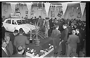 """Launch Of New Ford Corsair..1963..01.10.1963..10.01.1963..1st October 1963..Today saw the launch of a new car to the market. At the Smithfield Motor Company in Drumcondra, Ford launched """"The Corsair"""".,The Corsair was one of the four model Consul range, and shared many of its mechanical components with the Cortina, Classic and Capri. The Corsair had unusual and quite bold styling for its day, with a sharp horizontal V-shaped crease at the very front of the car into which round headlights were inset...Picture shows the level of interest generated by the launch of the new """"Corsair' by Ford."""