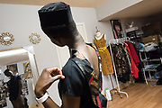 Model Setor Nyendu checks out a new look in the mirror during a fitting at Jacqueline Addison's studio in Northeast Minneapolis.