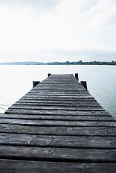 Landing stage wooden jetty lake water sunset