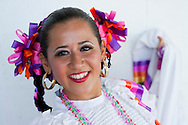 October 1st, 2011. Pico Rivera, California. Traditional charros (Mexican cowboys) compete in a Mexican Rodeo. The competition at the Pico Rivera Sports Arena is a display of horsemanship and lasso skills. Pictured is Mexican dancer, Viridiana Lopez (23)..PHOTO © JOHN CHAPPLE / www.johnchapple.com