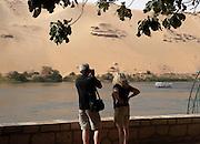 Couple on promenade along Nile River on Kitchener's Island, Aswan, Egypt
