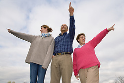 Group of people pointing in different directions,