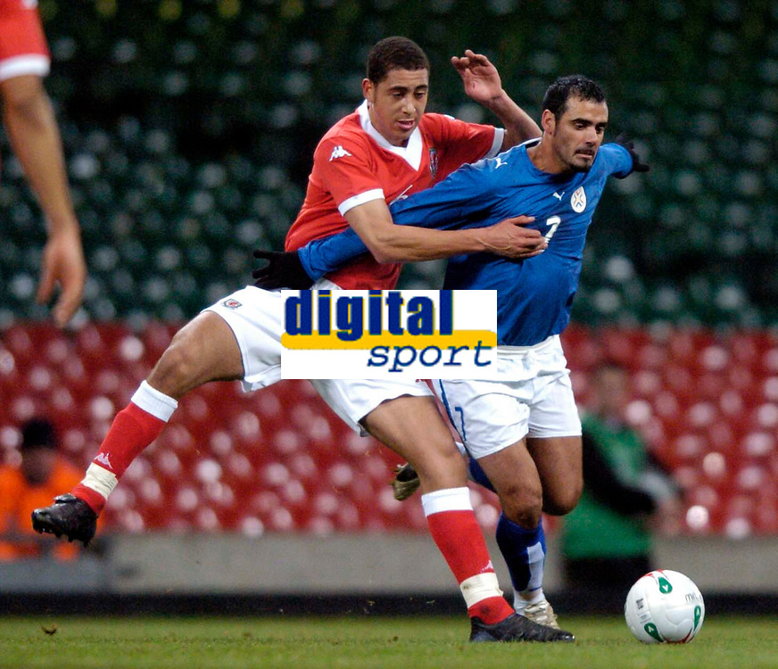 Photo: Richard Lane.<br />Wales v Paraguay. International Friendly. 01/03/2006. <br />Wales' Lewin Nyatanga (lt) on his debut challenges Cesar Ramirez.