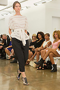 Black capri-length pants with white boat-neck top. By Carmen Marc Valvo at the Spring 2013 Fashion Week show in New York.