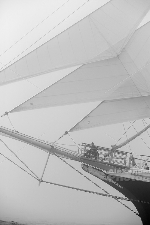 Newport, RI, USA - Handicapped crew member observe from wheelchair aboard Tallship 'Tenacious' from the United Kingdom during Tallships 2004 parade of sail. Black and white version.