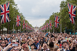 © Licensed to London News Pictures. 11/06/2016. London, UK. Thousands watch as planes from the Royal Air Force fly over Pall Mall in central London to conclude Trooping the Colour. Trooping the Colour, a military parade of the Queen's Household Division, takes place annually and this year marks Her Majesty's  official 90th birthday. Photo credit: Rob Pinney/LNP