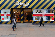People walk past a branch of T M Lewin displaying 60% off sale signs in Oxford Street, London, UK on January 03, 2019