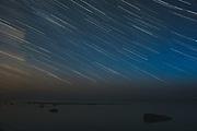 Long exposure of night skies and rocky coast of Baltic sea near Svētciems, Gulf of Riga, Latvia Ⓒ Davis Ulands | davisulands.com