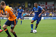 AFC Wimbledon midfielder Liam Trotter (14) dribbling during the EFL Sky Bet League 1 match between AFC Wimbledon and Oldham Athletic at the Cherry Red Records Stadium, Kingston, England on 21 April 2018. Picture by Matthew Redman.