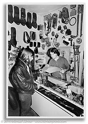 Kevin helping his friend Kirk in first 14th Street store. San Leandro, CA.  ©1972 Ness Family Archive Photo