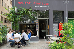 Small pavement restaurant in bohemian Prenzlauer Berg district of Berlin Germany
