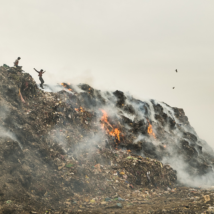 Recyclers in Bhalswa, on top of one of the giant open air garbage dump which burns 24/7, creating toxic fumes.<br /> Delhi, India