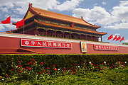 Entrance to Forbidden City with flowers in the foreground, Beijing, China