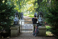Berlin, Germany - August 31, 2015: A couple stand next to their parked bicycles and kiss on a hot summer day in the Tiergarten, a 210-hectare (520-acre) park in the center of Berlin, Germany.