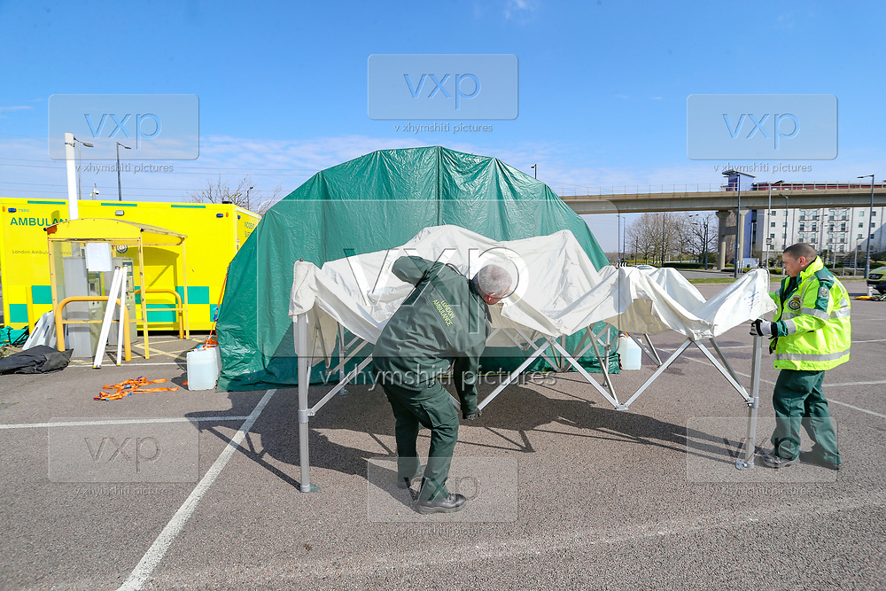 BRITAIN VIRUS OUTBREAK - NHS Support Unit personnel is seen setting up medical support hardware equipment at the ExCel Centre in London on Saturday, March 28, 2020.  NHS Nightingale makeshift hospital is being made into a temporary 4000-bed, comprising of two wards, each of 2,000 people, to help tackle the coronavirus outbreak in Britain. (Photo/Vudi Xhymshiti)