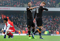 Football - 2016 / 2017 Premier League - Arsenal vs. Hull City<br /> <br /> Sam Clucas of Hull is consoled by Ahmed Elmohamady after being sent off for handling on the line at The Emirates.<br /> <br /> COLORSPORT/ANDREW COWIE
