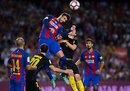 Gerard Pique jumps to remates theduring the La Liga match between Barcelona and Atletico Madrid at Camp Nou, Barcelona, Spain on 21 September 2016. Photo by Eric Alonso.