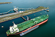 Nederland, Zuid-Holland, Rotterdam, 28-09-2014; Achtste Petroleumhaven,  Maasvlakte, met afgemeerde mammoettanker<br /> Eighth Petroleum harbour, Maasvlakte with moored super tanker.<br /> luchtfoto (toeslag op standard tarieven);<br /> aerial photo (additional fee required);<br /> copyright foto/photo Siebe Swart