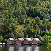 """Flåm means """"little place between steep mountains."""" It is located along the Aurlandsfjord, a tributary of the Sognefjord, the world's longest and deepest fjord."""