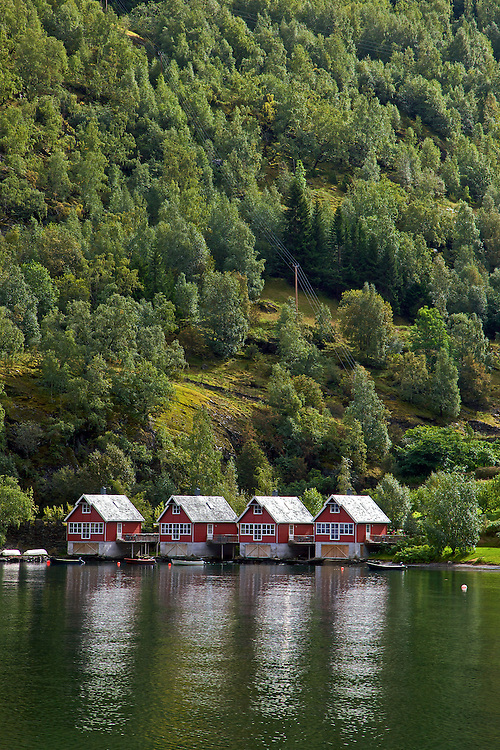 "Flåm means ""little place between steep mountains."" It is located along the Aurlandsfjord, a tributary of the Sognefjord, the world's longest and deepest fjord."